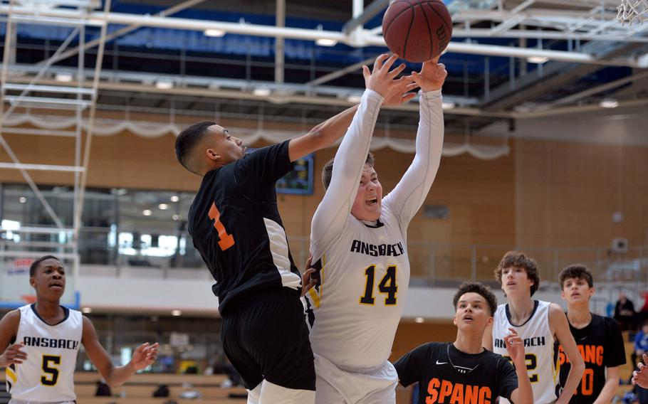 Heriberto DeJesus II of Spangdahlem and Dustin Martin of Ansbach fight for a rebound in a Division II semifinal at the DODEA-Europe basketball championships in Wiesbaden, Germany, Friday, Feb. 21, 2020.