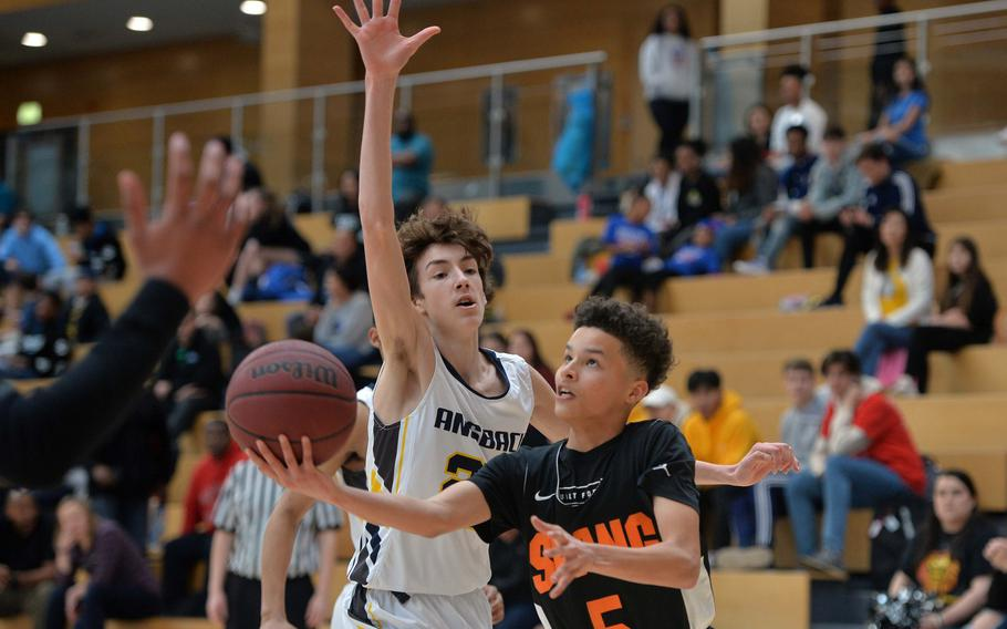 Antonio DeJesus of Spangdahlem goes in for an underhand layup against Alexander Adams of Ansbach in a Division II semifinal at the DODEA-Europe basketball championships in Wiesbaden, Germany, Friday, Feb. 21, 2020.
