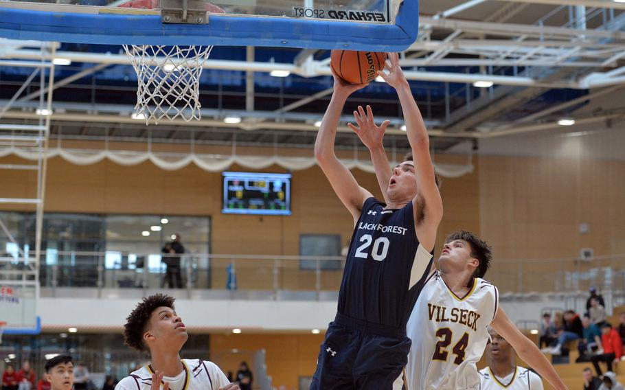 Mathew Stemple of Black Forest Academy gets past Sean Bergosh for a basket in a Division I semifinal at the DODEA-Europe basketball championships in Wiesbaden, Germany, Friday, Feb. 21, 2020.