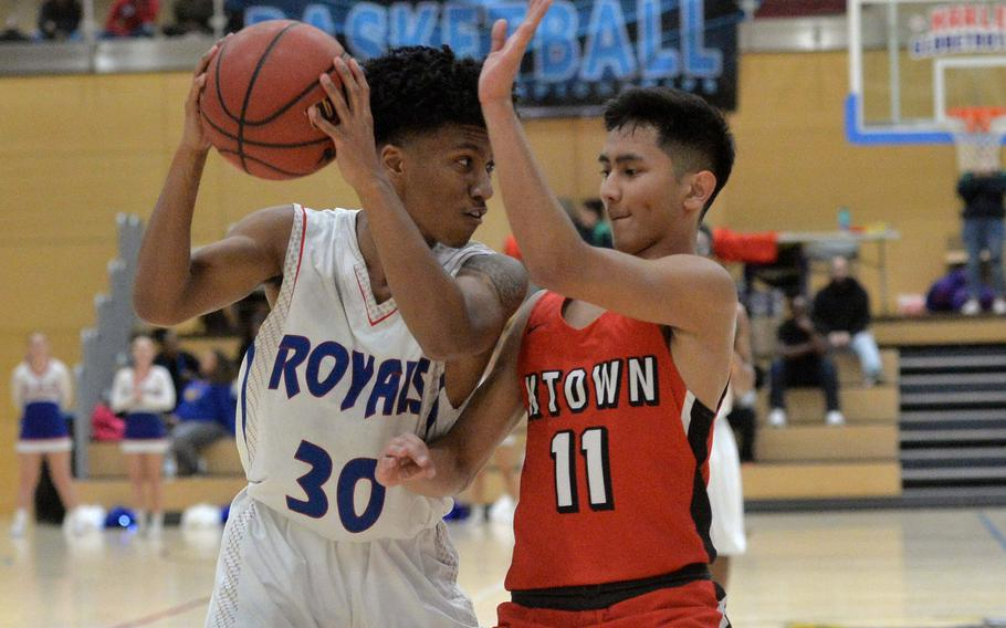 Jerod Little of Ramstein and Caleb Penaflor are eye-to-eye in a Division I semifinal at the DODEA-Europe Division I basketball championships in Wiesbaden, Germany, Friday, Feb. 21, 2020. Ramstein won 50-43.