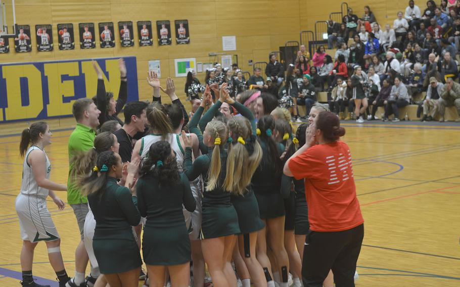 SHAPE players and fans celebrate advancing to the school's first Division I basketball final after the Spartans defeated Ramstein 36-24, in Wiesbaden High School on Friday, Feb. 21, 2020.