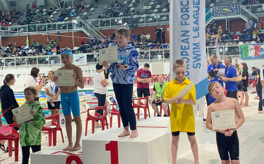 Kaiserslautern swimmer Jacob Furqueron, center, placed first for the boys 9-year-old pentathlon (that consisted of freestyle, backstroke, breaststroke, butterfly and the individual medley) during the European Forces Swim League championships in Eindhoven, Netherlands, Saturday, Feb. 29, 2020.