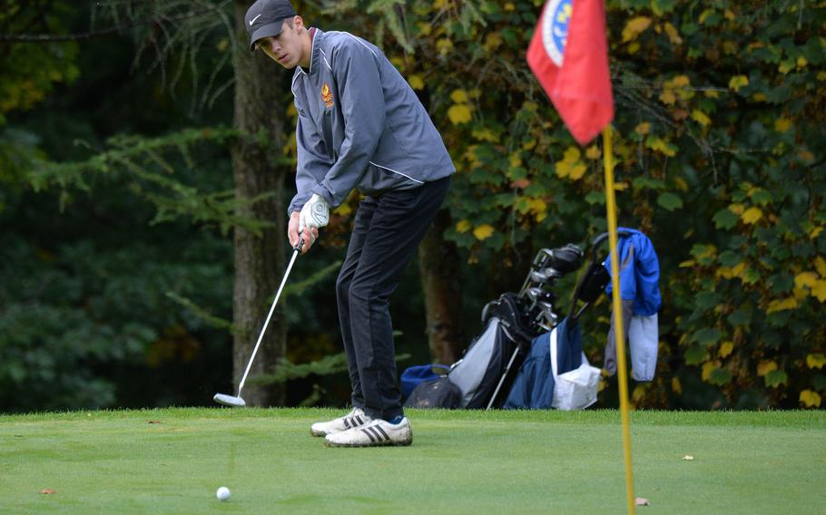 Vilseck's Rian Ritter watches his putt curve towards the pin in opening day action at the DODEA-Europe golf championships at Rheinblick Golf Course in Wiesbaden, Wednesday, Germany, Oct. 7, 2020.