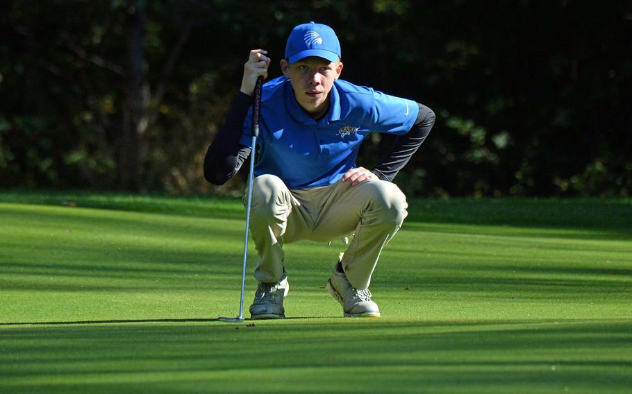 Defending boys champion Clayton Shenk of Wiesbaden studies the green before making a putt during opening day action at the DODEA-Europe golf championships at Rheinblick Golf Course in Wiesbaden, Germany, Wednesday, Oct. 7, 2020.