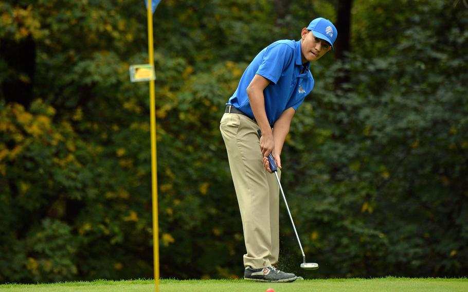 Wiesbaden's Gilbert Bustillos watches his putt head towards the pin in opening day action at the DODEA-Europe golf championships at Rheinblick Golf Course in Wiesbaden, Germany, Wednesday, Oct. 7, 2020.