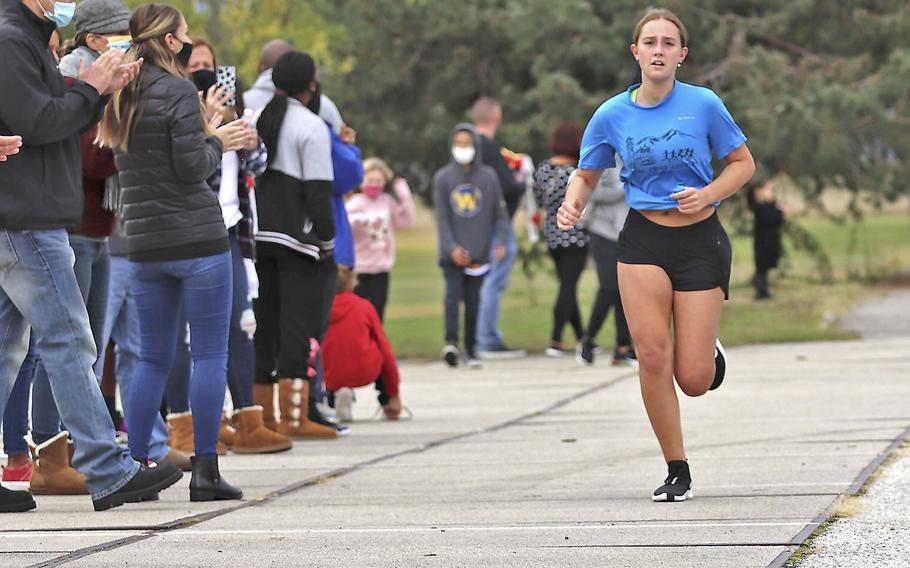 Sirin Whitcomb sprints to the finish line during Saturday's cross country meet at Aviano. A total of 15 runners competed in the event where Whitcomb finished with a time of 34 minutes, 38 seconds.