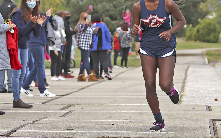 Zurnia Dickerson approaches the finish line during Saturday's cross country meet at Aviano.