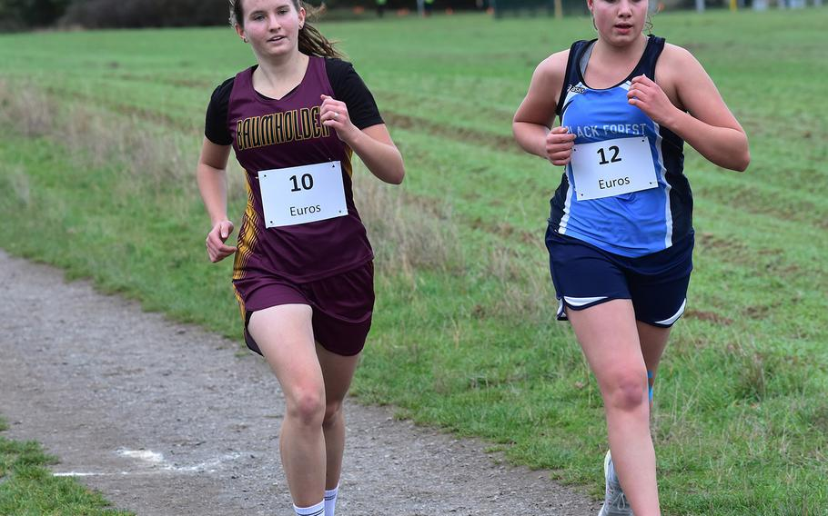 Black Forest Academy's Elmi-gret Van der Westhuizen runs alongside Baumholder's Madison Brech at the DODEA-Europe non-virtual championship on Saturday, Oct. 24, 2020, in Ramstein-Miesenbach, Germany. Van der Westhuizen won the small schools' division race and placed 12th overall.