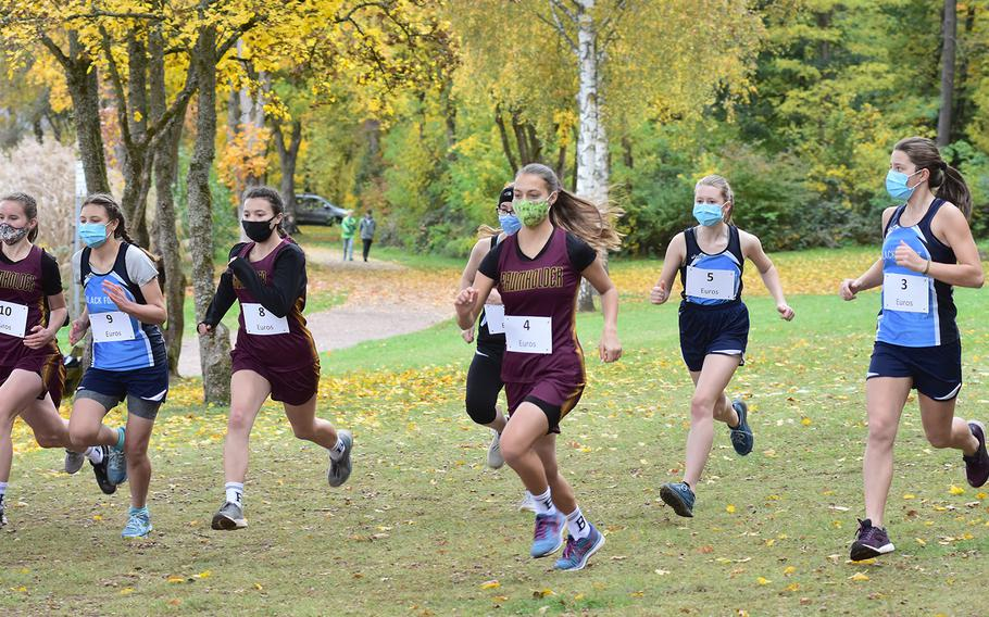 The start of the small schools' girls race at the DODEA-Europe non-virtual championship on Saturday, Oct. 24, 2020, featured teams from Baumholder, Black Forest Academy and Spangdahlem. Runners had to wear face masks at the start but could remove them after the race began. The meet was held at the Seewoog Park in Ramstein-Miesenbach, Germany.
