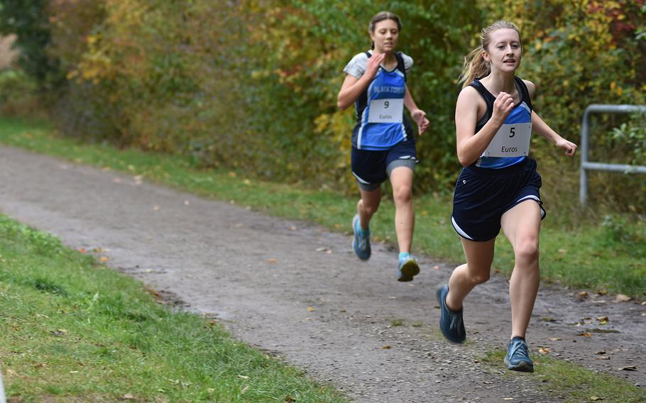 Black Forest Academy's Havelah Trusty leads teammate Carolyn Randles during the DODEA-Europe non-virtual cross country championship on Saturday, Oct. 24, 2020. BFA participated in the small schools' race with Spangdahlem and Baumholder.