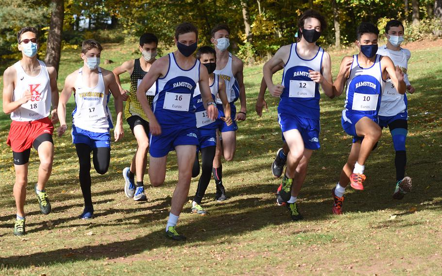 Runners sprint from the starting line at the DODEA-Europe non-virtual cross country championship on Saturday, Oct. 24, 2020. Teams from Ramstein, Wiesbaden, Kaiserslautern and Stuttgart competed in the large schools division race. Due to coronavirus restrictions, only teams from Germany were able to compete at Seewoog Park in Ramstein-Miesenbach, Germany.