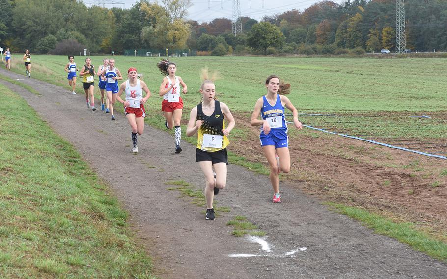 Stuttgart's Ella Bishop and Wiesbaden's Kaitlyn Taylor took the lead early on at the DODEA-Europe non-virtual cross country championship on Saturday, Oct. 24, 2020, at Seewoog Park in Ramstein-Miesenbach, Germany. Bishop won the race on the 3.1-mile course in 20:05.22.