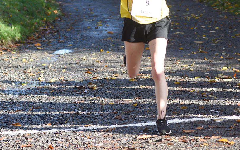 Stuttgart's Ella Bishop crosses the finish line first at the DODEA-Europe non-virtual cross country championship on Saturday, Oct. 24, 2020, at Seewoog Park in Ramstein-Miesenbach, Germany.