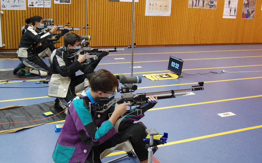 Judah Zaragoza, from right, Josh Thresher, Jaden Anderson and Lidia Mason compete in the kneeling position for Wiesbaden on Saturday, March 20, 2021, during the DODEA-Europe marksmanship championships.