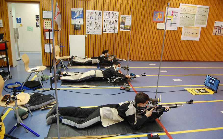 Josh Thresher, from right to left, Jaden Anderson and Lidia Mason fire from the prone position for Wiesbaden on Saturday, March 20, 2021, during the DODEA-Europe marksmanship championships.