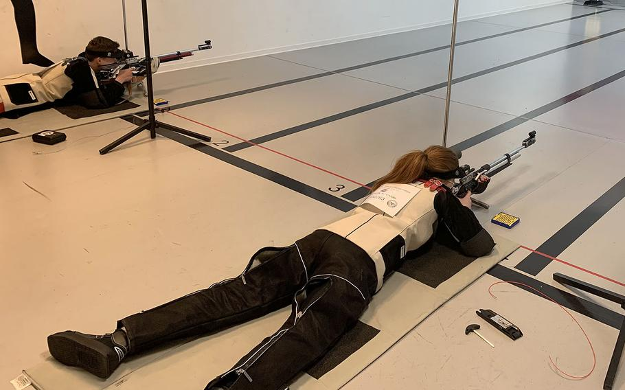 Aiden Malcolm, left, and Vivian Dougherty shoot from the prone position during Kaiserslautern's participation in the Air Force JROTC precision class championships earlier this month. The Raiders won the competition for the second straight year.