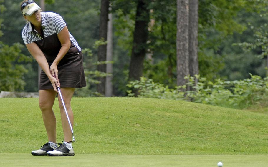 Pam Lewers, a civilian worker at Ramstein Air Base, putts towards the cup Thursday at Woodlawn Golf Club's 9th hole during the U,.S. Air Forces in Europe golf championships in Ramstein, Germany.