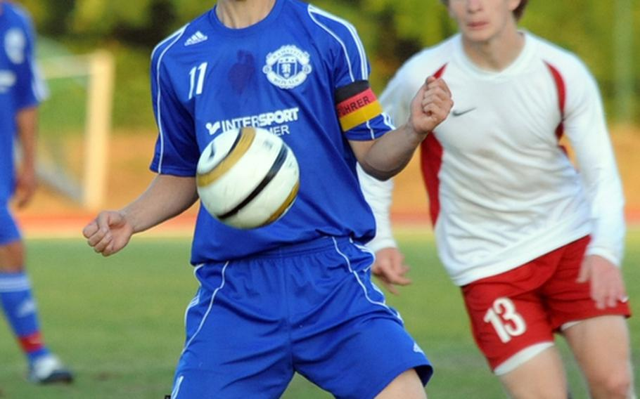 Ramstein's Jonathan McLouth, left, controls the ball as Lakenheath's Joseph Sullivan comes up to help defend during the Division I championship game at the DODDS-Europe soccer finals in May. Both players have been selected to the 2011 All-Europe squad.