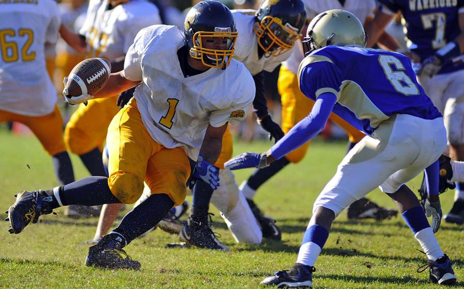 Heidelberg's Chris Cuthbert, left, looks Wiesbaden's Khari Bennett in the eyes as he picks up yardage in a game in Wiesbaden on Oct. 9, 2010. Cuthbert has been selected the 2011 DODDS-Europe male athlete of the year.