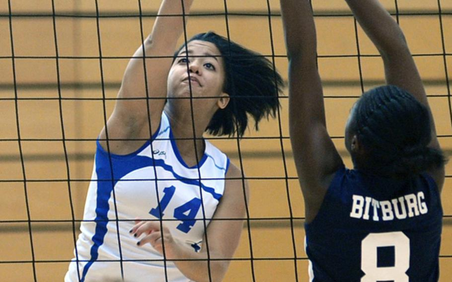 Wiesbaden's LeAmber Thomas, left, knocks the ball over Ellisia Kimble's outstretched arms in Wiesbaden's 25-16, 25-14, 25-13 win over the visiting Bitburg Lady Barons on Oct. 9, 2010.  Thomas, who recently graduated from Wiesbaden High School, has been named the 2011 DODDS-Europe female athlete of the year.