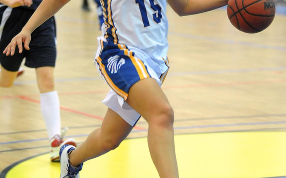 LeAmber Thomas looks to the basket as she drives the ball up the court at the DODDS-Europe basketball championships in Mannheim in February. Thomas, who recently graduated from Wiesbaden High School, has been named the 2011 DODDS-Europe female athlete of the year.