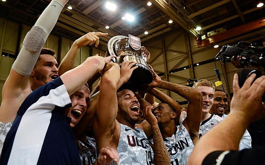 Connecticut players celebrate after they upset No. 14 Michigan State 66-62 in the Armed Forces Classic at Ramstein Air Base, Germany, on Nov. 9, 2012.