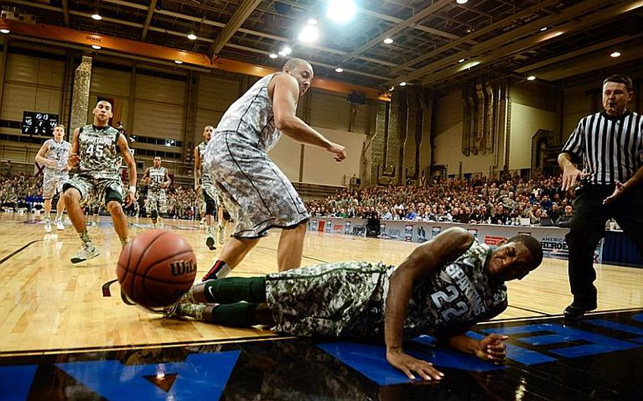 Michigan State's Branden Dawson is fouled hard by Connecticu's R.J. Evans Nov. 9, 2012, in the Armed Forces Classic at Ramstein Air Base, Germany. Connecticut upset No. 14 Michigan State 66-62.