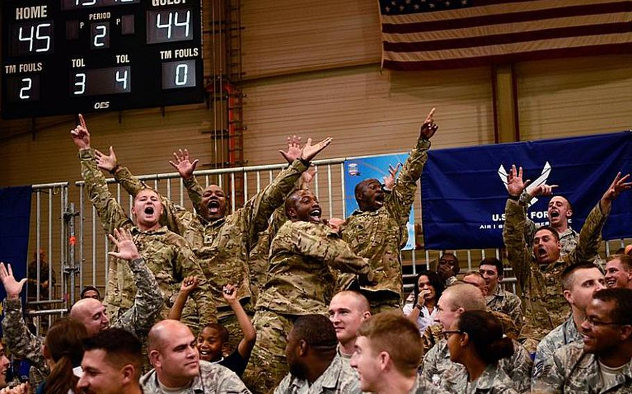 Servicemembers react to the music Nov. 9, 2012, at the Armed Forces Classic at Ramstein Air Base, Germany. Connecticut upset No. 14 Michigan State 66-62.
