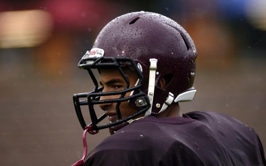 Baumholder High School's Ben McDaniels glances toward the stands on his way back to his team's  huddle. McDaniels led his team to a rain-soaked 2012 DODDS-Europe football championship in Baumholder, Germany. McDaniels was named Stars and Stripes' football Athlete of the Year.