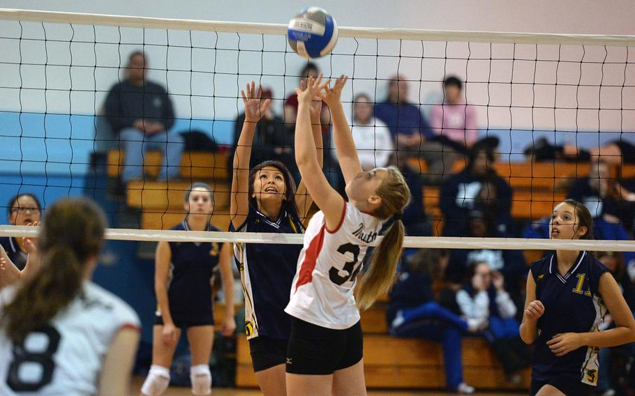 Leah Mendiola, left, and Menwith Hill's Alley LaPlante battle at the net in a Division III match at the DODSS-Europe volleyball championships, Nov. 1, 2013. Lajes defeated the Mustangs 14-25, 25-21, 15-6.