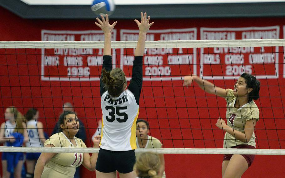 Patch's Jaxen Godrey tries to block a shot by Vilseck's Elizabeth Siantini, right, in a Division I match at the DODDS-Europe volleyball championships, Nov. 1, 2013. Patch won 25-11, 25-11.
