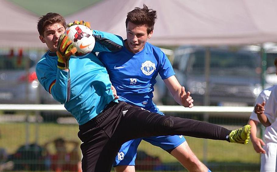 Vilseck's Timothy Simmons pulls in the ball in front of Ramstein's Connor Settle in Division I action at the DODEA-Europe soccer championships in Reichenbach, Germany. Ramstein won 3-2.