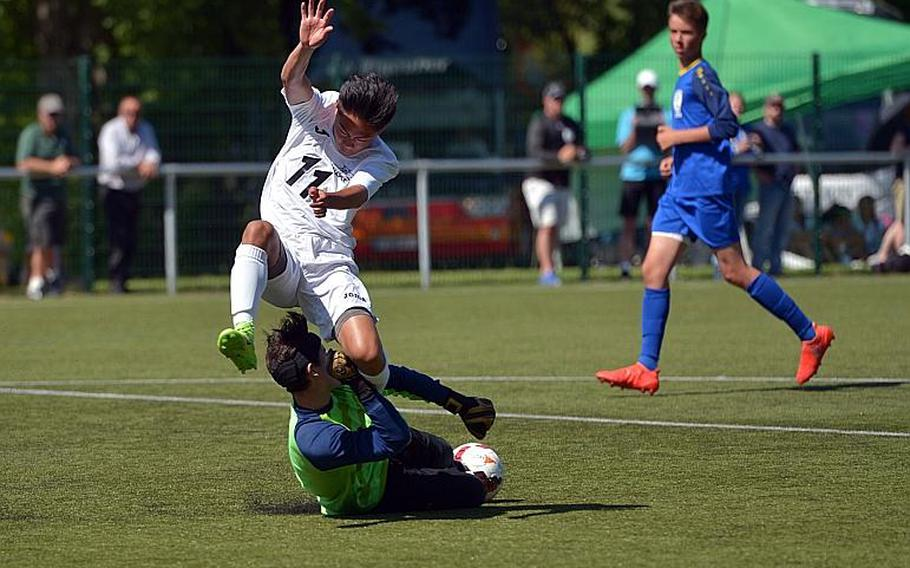Wiesbaden keeper Matias Chavez comes out to stop Naples' Ryan Ramirez in a Division I game at the DODEA-Europe soccer championships in Reichenbach, Germany. Naples won the game 2-1.