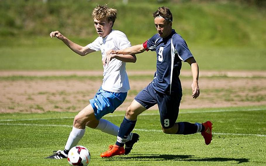 Bitburg's Sage Kown, right, and Marymount's Giovanni Taricone race for the ball during the DODEA-Europe soccer tournament in Landstuhl, Germany, on Wednesday, May 17, 2017. Marymount won the Division II match 3-1.  MICHAEL B. KELLER/STARS AND STRIPES