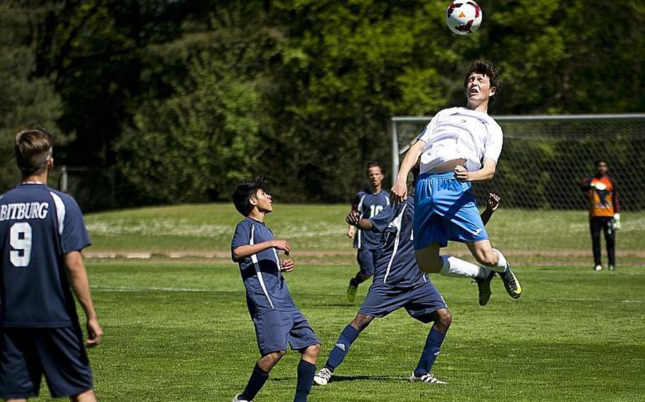 Marymount's Antonio Di Tommaso, right, jumps for a header over Bitburg's Luis Funez during the DODEA-Europe soccer tournament in Landstuhl, Germany, on Wednesday, May 17, 2017. Marymount won the Division II match 3-1.  MICHAEL B. KELLER/STARS AND STRIPES