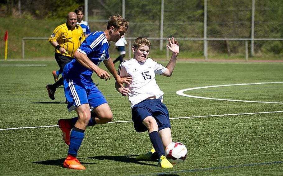 Black Forest Academy's Jonah Olson, right, tries to pass the ball past Rota's Samuel Weaver during the DODEA-Europe soccer tournament in Landstuhl, Germany, on Wednesday, May 17, 2017. Rota and BFA finished the the Division II match 2-2.  MICHAEL B. KELLER/STARS AND STRIPES