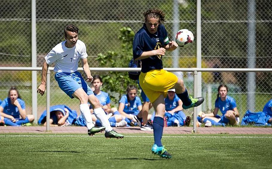 Marymount's Julien Van Hensbeng, left, passes the ball past Florence's Gabriele Lapi during the DODEA-Europe soccer tournament in Landstuhl, Germany, on Wednesday, May 17, 2017. Marymount won the Division II match 5-2.  MICHAEL B. KELLER/STARS AND STRIPES