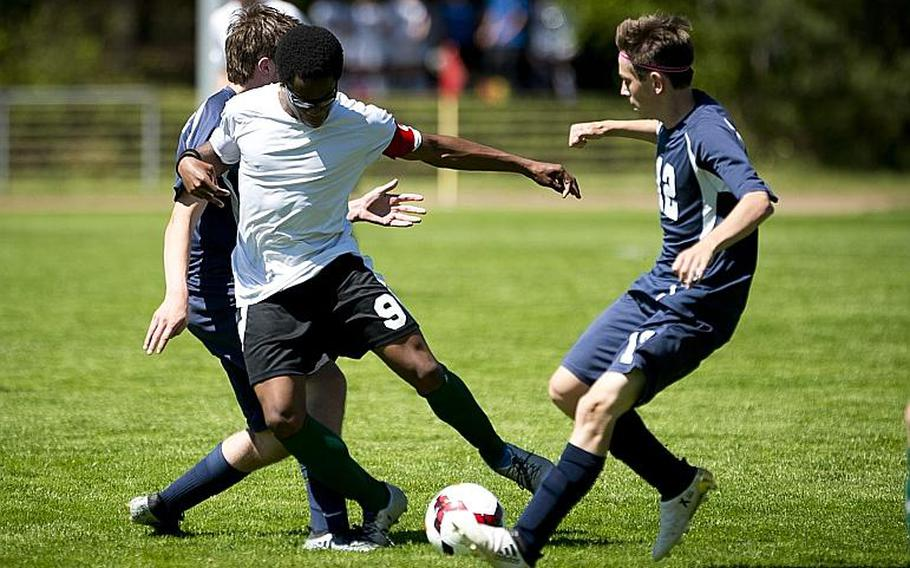 AFNORTH's Jordan Clement tries to split Bitburg's Mike Ohl, right, and Stephen Taylor during the DODEA-Europe soccer tournament in Landstuhl, Germany, on Wednesday, May 17, 2017. AFNORTH and Bitburg finished the Division II match 1-1.