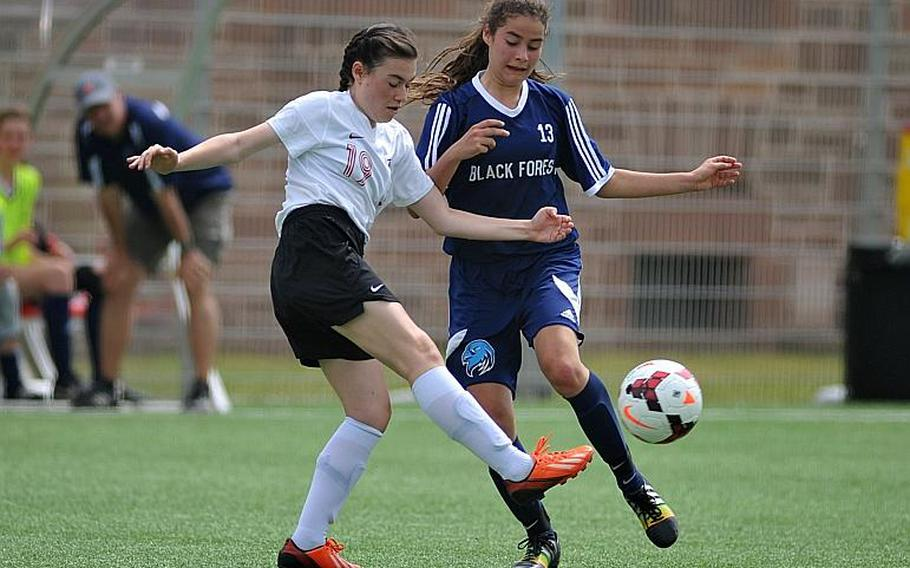American Overseas School of Rome's Sofia Gaeta clears the ball in front of Black Forest Academy's Deborah Widmer in Division II action at the DODEA-Europe soccer championships in Landstuhl, Germany. BFA won 4-1.