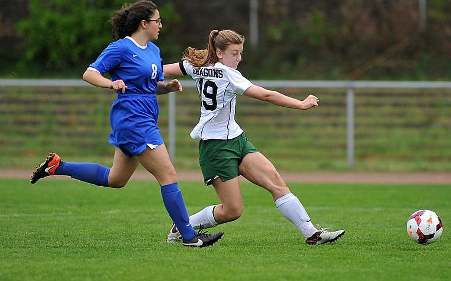 Alconbury's Laela Evans scores a goal as Brussels' Ece Kilinc tries to defend. Alconbury beat Brussels 3-1 in Division III action at the DODEA-Europe soccer championships in Landstuhl, Germany.