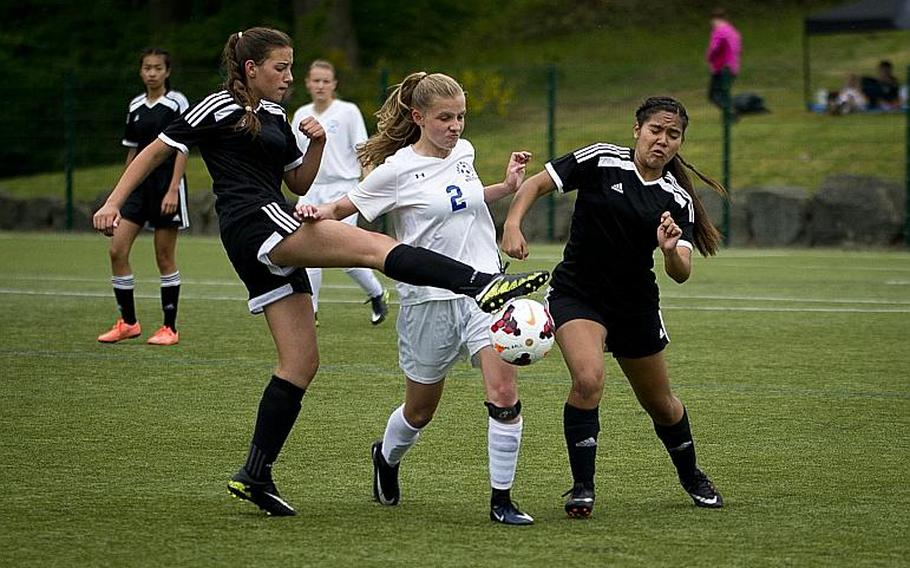 Wiesbaden's Peggy Sue Mathis tries to get between Vicenza's Hope Bello, left, and Mia Soto during the DODEA-Europe soccer tournament in Reichenbach, Germany, on Thursday, May 18, 2017. Wiesbaden won the Division I match against Vicenza 4-0 and advances to the semifinals.  MICHAEL B. KELLER/STARS AND STRIPES