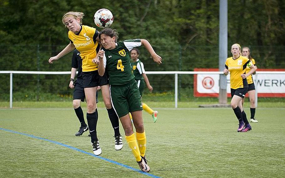Stuttgart's Caylee Creer, left, and SHAPE's Isabella Ortez jump for a header during the DODEA-Europe soccer tournament in Reichenbach, Germany, on Thursday, May 18, 2017. Stuttgart won the Division I match 7-0 and advanced to the semifinals.  MICHAEL B. KELLER/STARS AND STRIPES