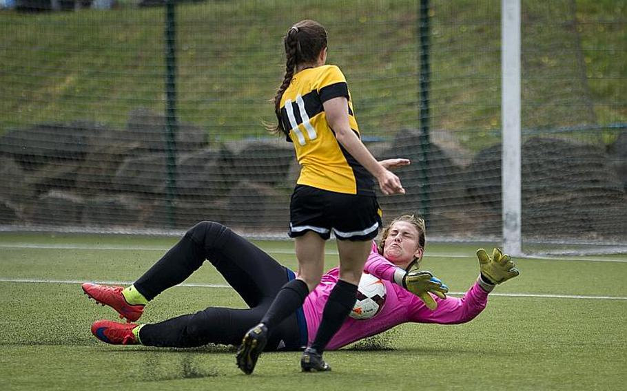 SHAPE's Megan Vanheuckelom, right, blocks a shot by Stuttgart's Janey Greenberg during the DODEA-Europe soccer tournament in Reichenbach, Germany, on Thursday, May 18, 2017. SHAPE lost the Division I match 7-0.  MICHAEL B. KELLER/STARS AND STRIPES