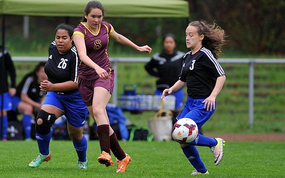 Baumholder's Taylor Lynch sends a ball upfield after getting past Hohenfles' Bryana Bentley, left, and Kayleigh Leandro n a Division III game at the DODEA-Europe soccer championships in Landstuhl, Germany.