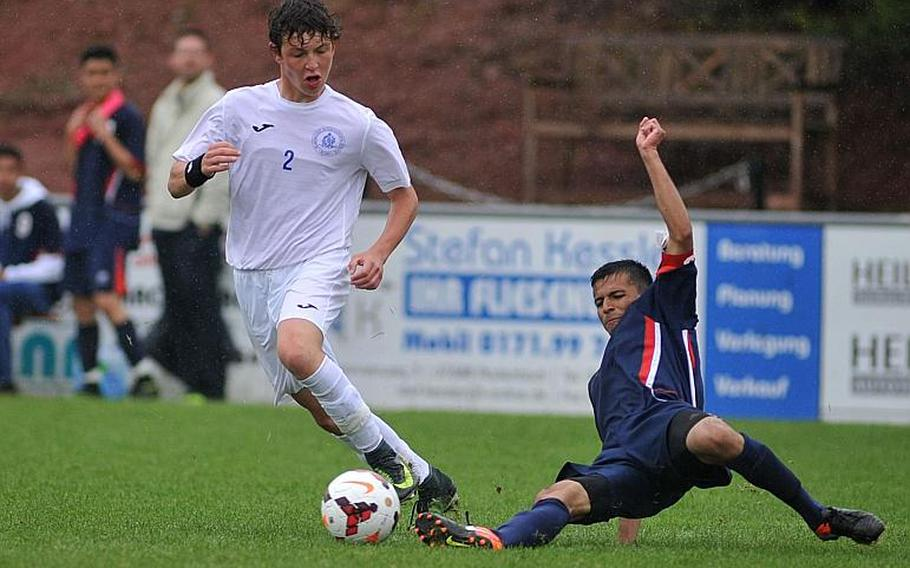Aviano's Ruben Valladares Cruz slides in to take the ball from Marymount's Antonio Di Tommaso in a Division II semifinal at the DODEA-Europe soccer championships in Reichenbach, Germany. Marymount won 1-0 to advance to Saturday's finals.