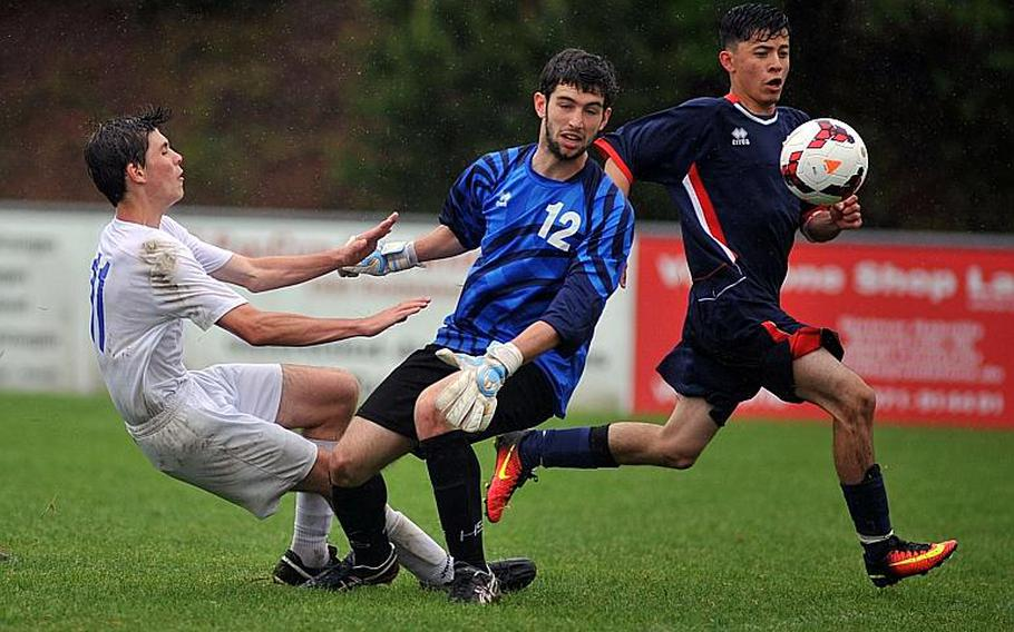 Aviano keeper Giocomo Fabbro gets a piece of  the ball to deflect a shot by Marymount's Alexander Herne in a Division II semifinal at the DODEA-Europe soccer championships in Reichenbach, Germany. A teammate cleared the ball from the goal line. Marymount won 1-0 to advance to Saturday's finals.