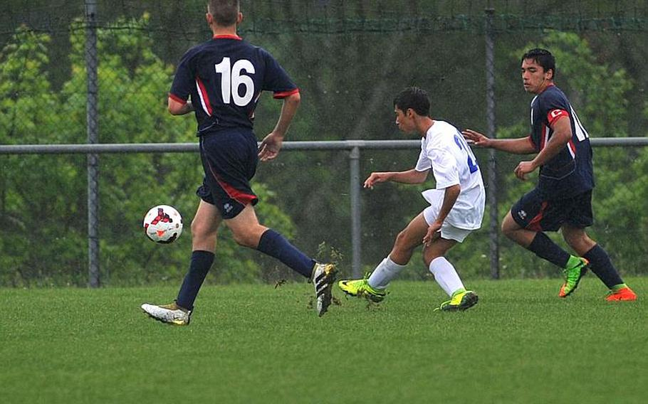 Marymount's Giovanni Taricone scores the winning goal in his team's 1-0 victory over Aviano in a Division II semifinal at the DODEA-Europe soccer championships in Reichenbach, Germany. At left is Jacob Cleveland, at right, Miguel Mosquera.