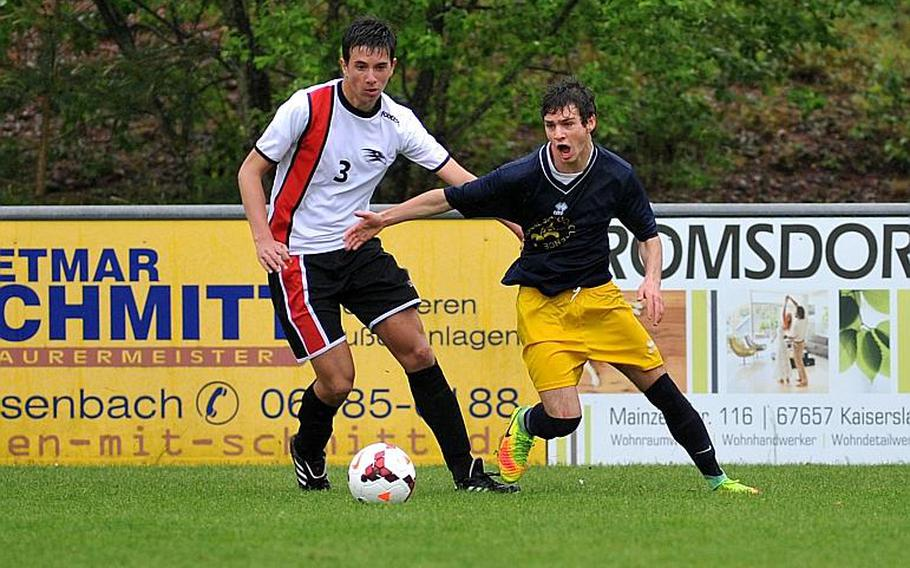 AOSR's Giuseppe Amara grabs the jersey of Florence's Cristoforo Burgisser to slow him down in a Division II semifinal at the DODEA-Europe soccer championships in Reichenbach, Germany. AOSR beat Florence 6-4 to advance to Saturday's final against Marymount.