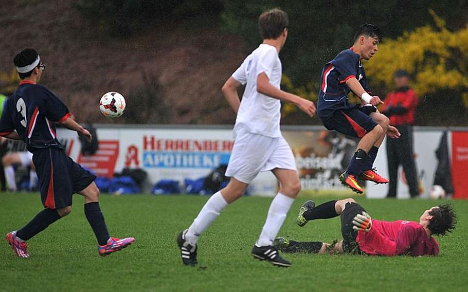 Aviano's Jason Valladares Cruz leaps over Marymount's Renato Andreozzi after the keeper cleared a pass in a Division II semifinal at the DODEA-Europe soccer championships in Reichenbach, Germany. Marymount won 1-0 to advance to Saturday's finals.