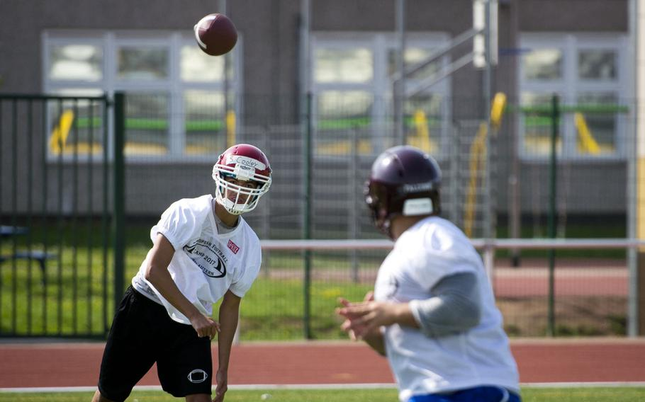 Kaiserslautern's Stephan Cooley, left, passes the ball to Vilseck's Juan Oestreich during football camp at Vogelweh, Germany, on Tuesday, Aug. 15, 2017.